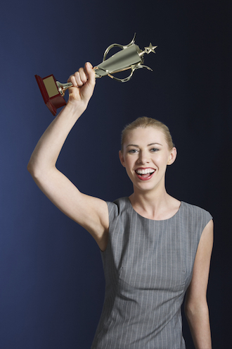 Career woman with trophy