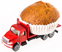 Muffin on a red dump truck