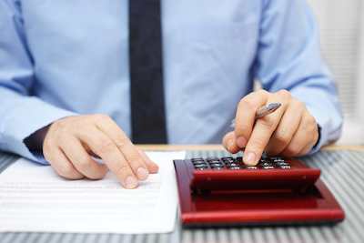 Man calculating recruiter agency fees