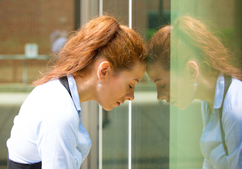 Woman at work dealing with emotional reactions such as anxiety