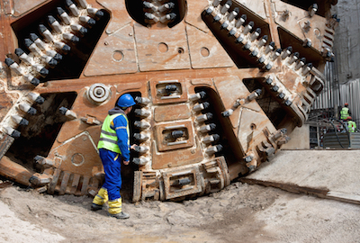 Underground tunnel building with a boring machine cutter head
