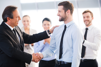 Boss saying good job to improve employee retention